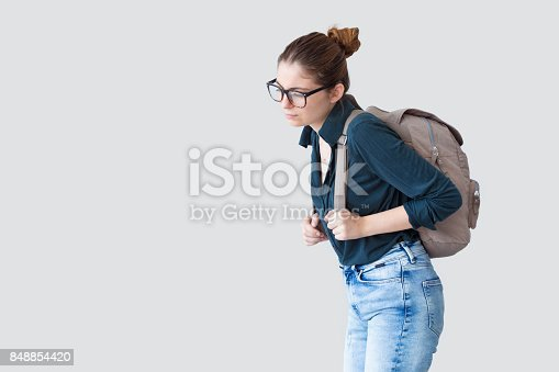 istock Student girl with heavy schoolbag 848854420