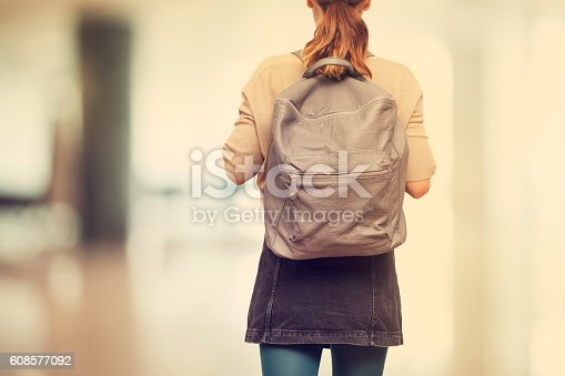 istock Student girl  with schoolbag 608577092