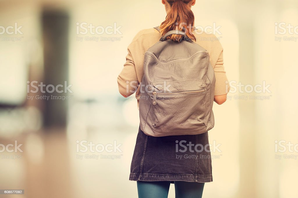 Student girl  with schoolbag стоковое фото