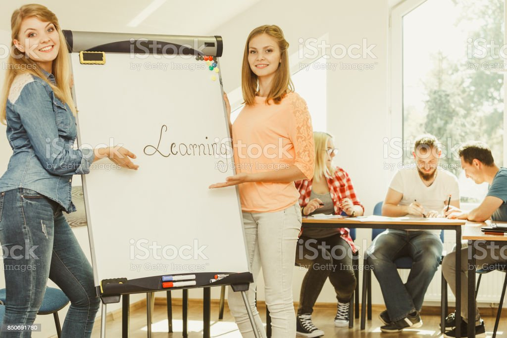 Student girl writting Learning word on whiteboard stock photo
