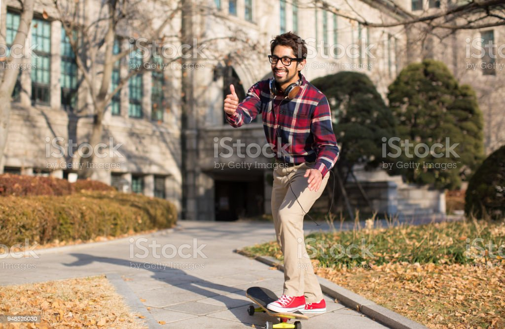 A Student Giving a Thumbs Up. stock photo