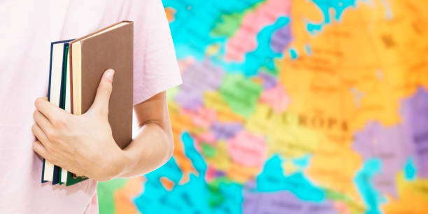 student hand with books and map, learn languages student hand with books and map, learn languages Anglo American stock pictures, royalty-free photos & images