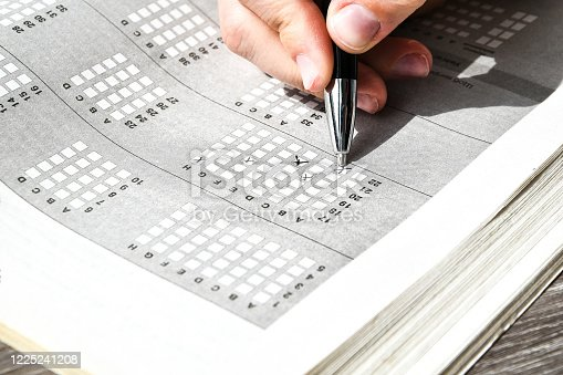 806639724 istock photo Student hand with pencil for the exam. printed school test, home education 1225241208