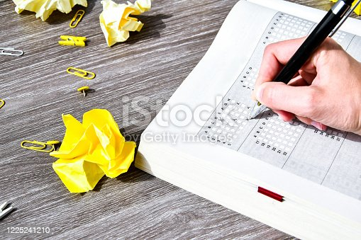 806639724 istock photo Student hand with pencil for the exam. printed school test, home education 1225241210