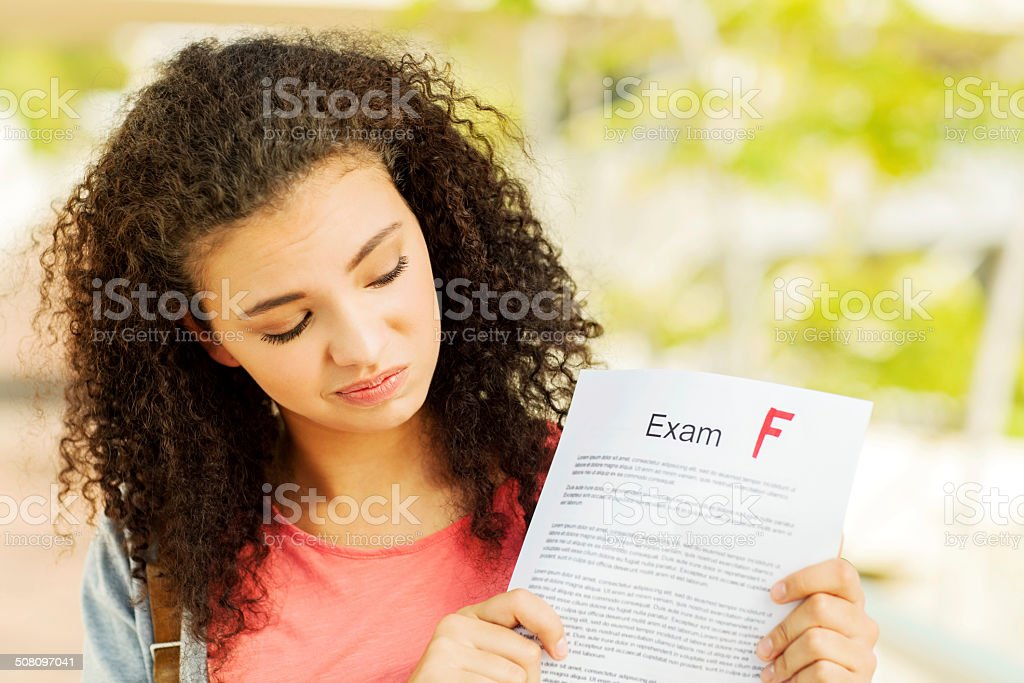Student Holding Exam Result With F Grade On Campus stock photo