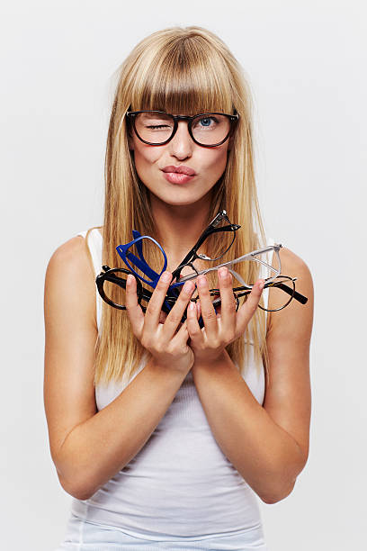 Student holding heap of glasses stock photo