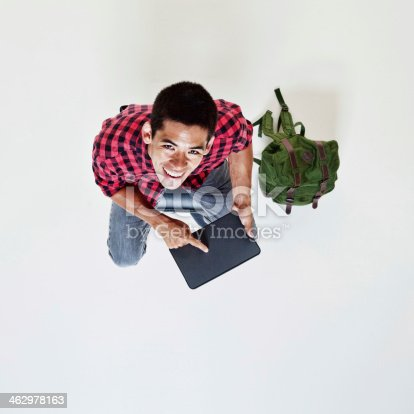 istock Student holding tablet pc 462978163