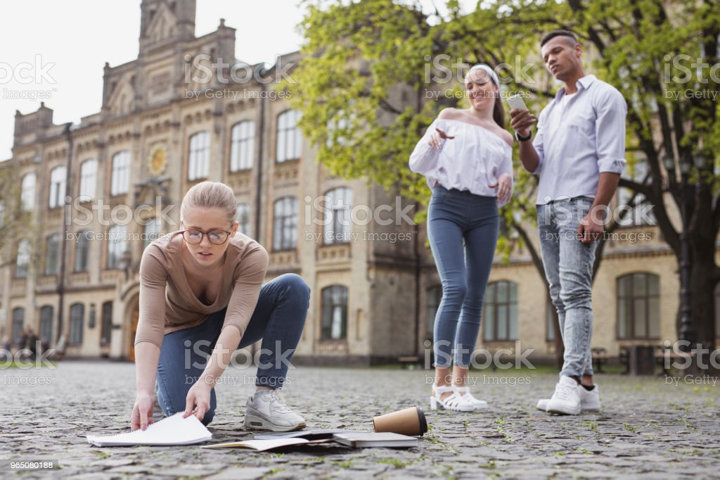 Student in glasses dropping her notebooks on the floor royalty-free stock photo