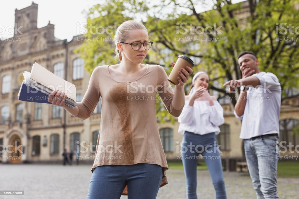 Student in glasses feeling awful after spilling her drink royalty-free stock photo
