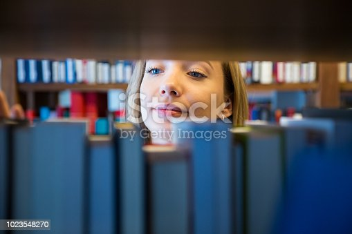 1023548222 istock photo Student in library 1023548270