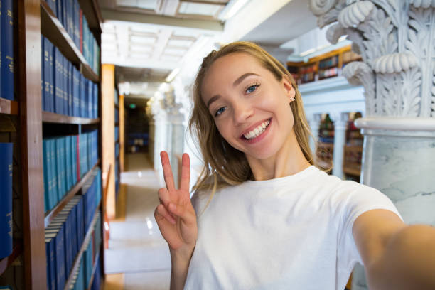 student in library - beautiful college girl pics stock photos and pictures