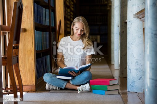 1023548222 istock photo Student in library 1023550562