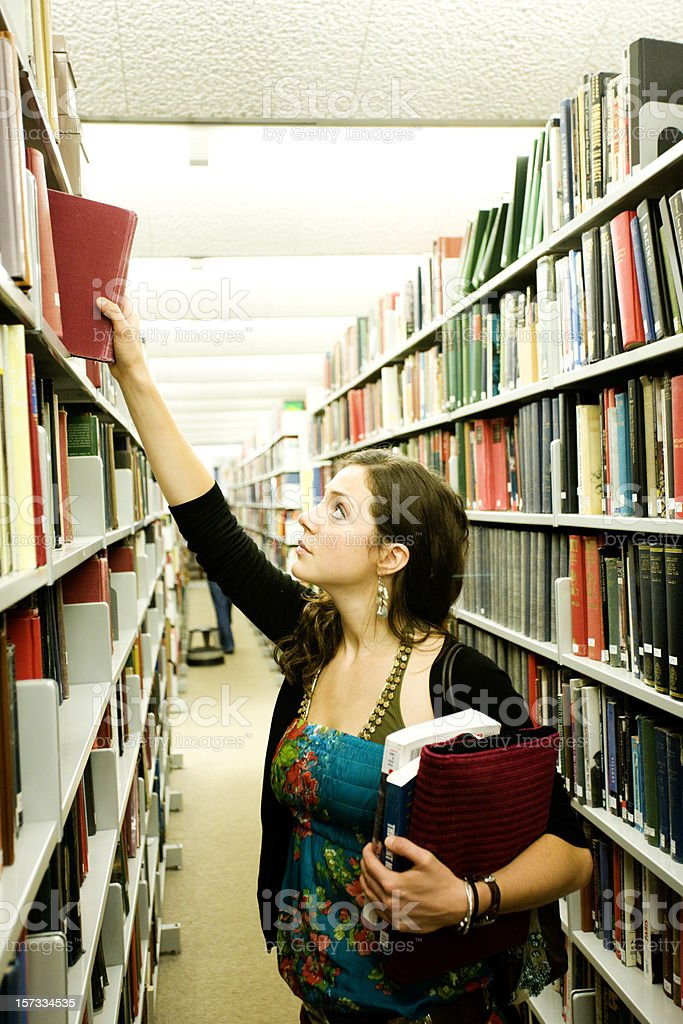 Student in library royalty-free stock photo