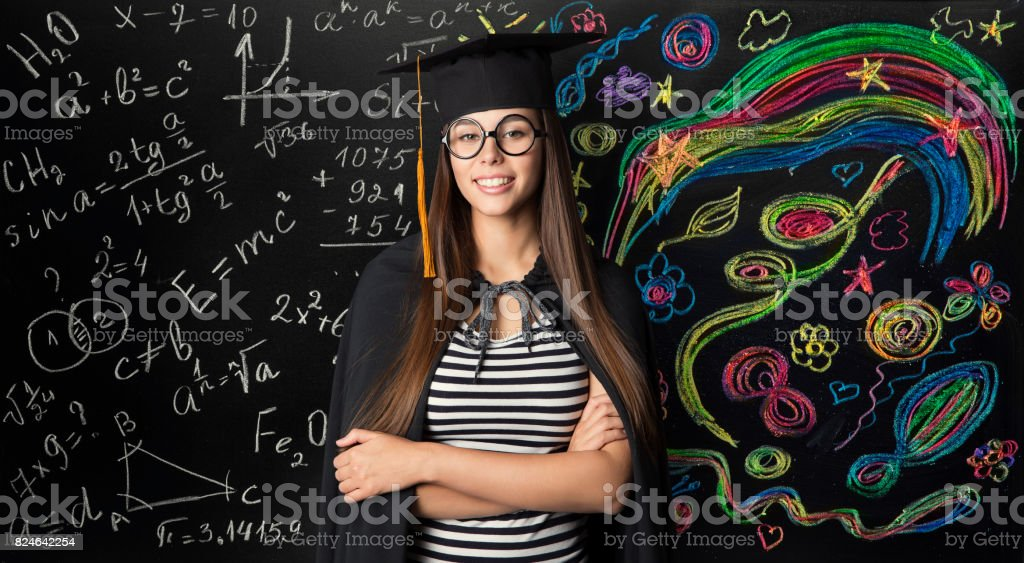 Student in Mortarboard Graduation Hat, Young Woman Learning Mathematics and Creative Art stock photo