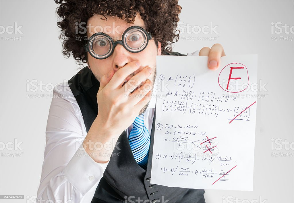 Student is disappointed from math exam results (F grade). stock photo