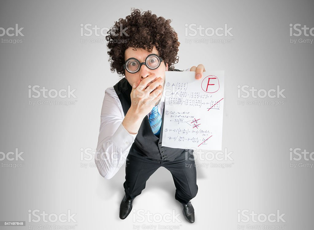 Student is showing math exam with F grade. stock photo