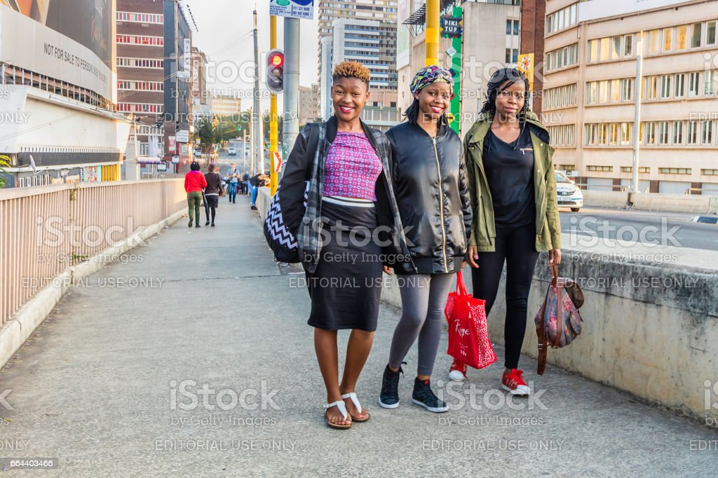 Student ladies seen crossing the Nelson Mandela bridge stock photo