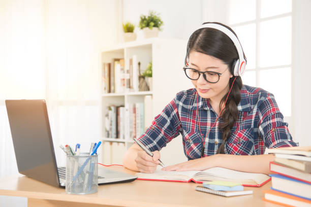 student learning on line with headphones stock photo