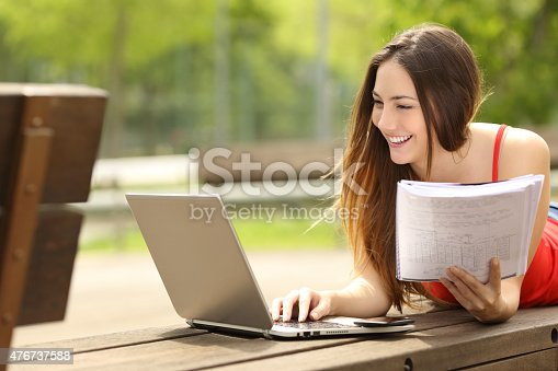 istock Student learning with a laptop in an university campus 476737588