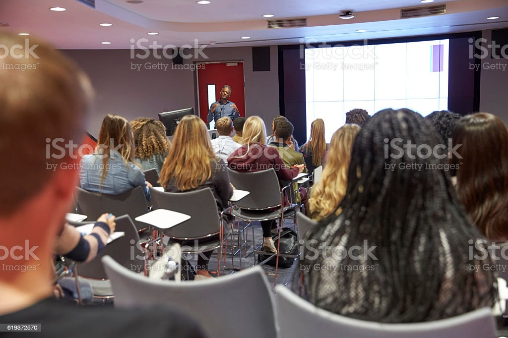 Student lecture in modern university classroom, back view stock photo