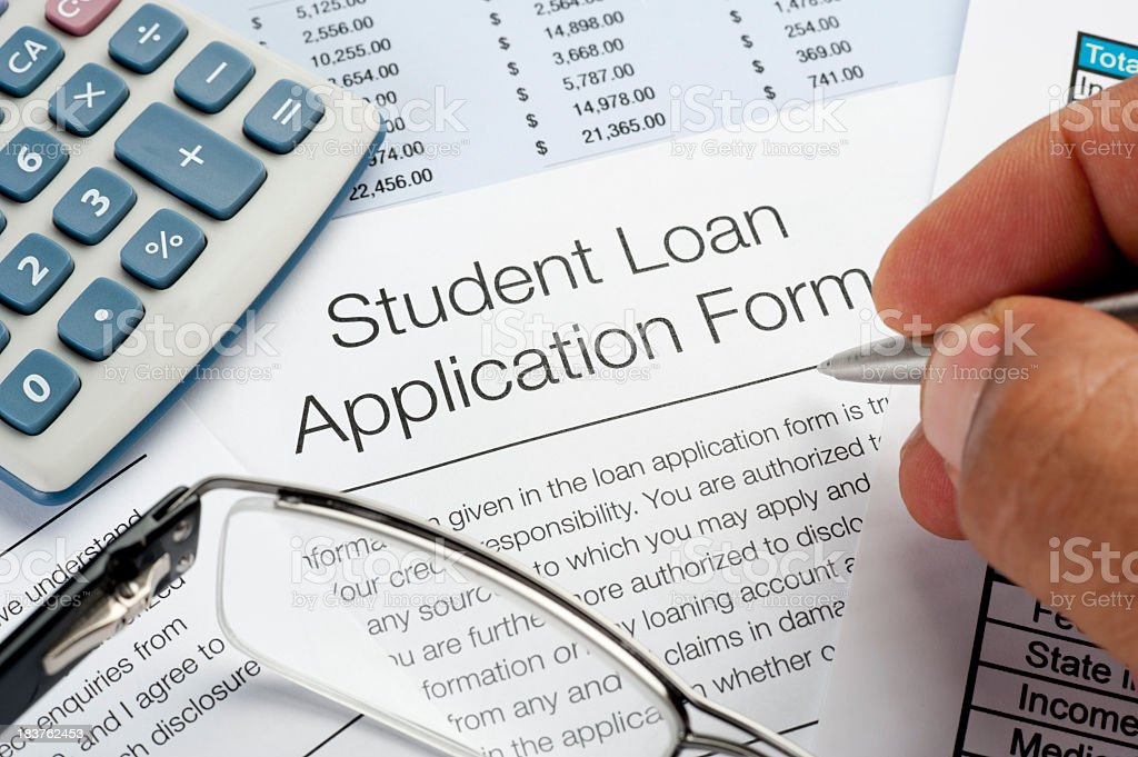Student Loan application Form with pen, calculator and writing h royalty-free stock photo