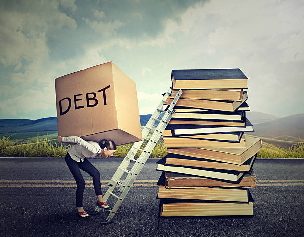 Student loan debt concept. Woman with heavy box Student loan debt concept. Young woman with heavy box full of debt carrying it up the education ladder borrowing stock pictures, royalty-free photos & images