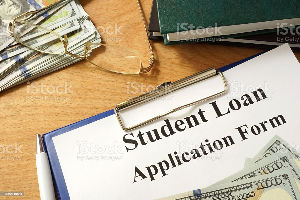 Student loan form with dollars and books. stock photo