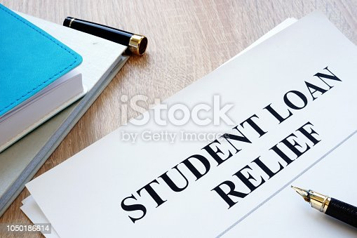 Student loan relief papers on the desk.