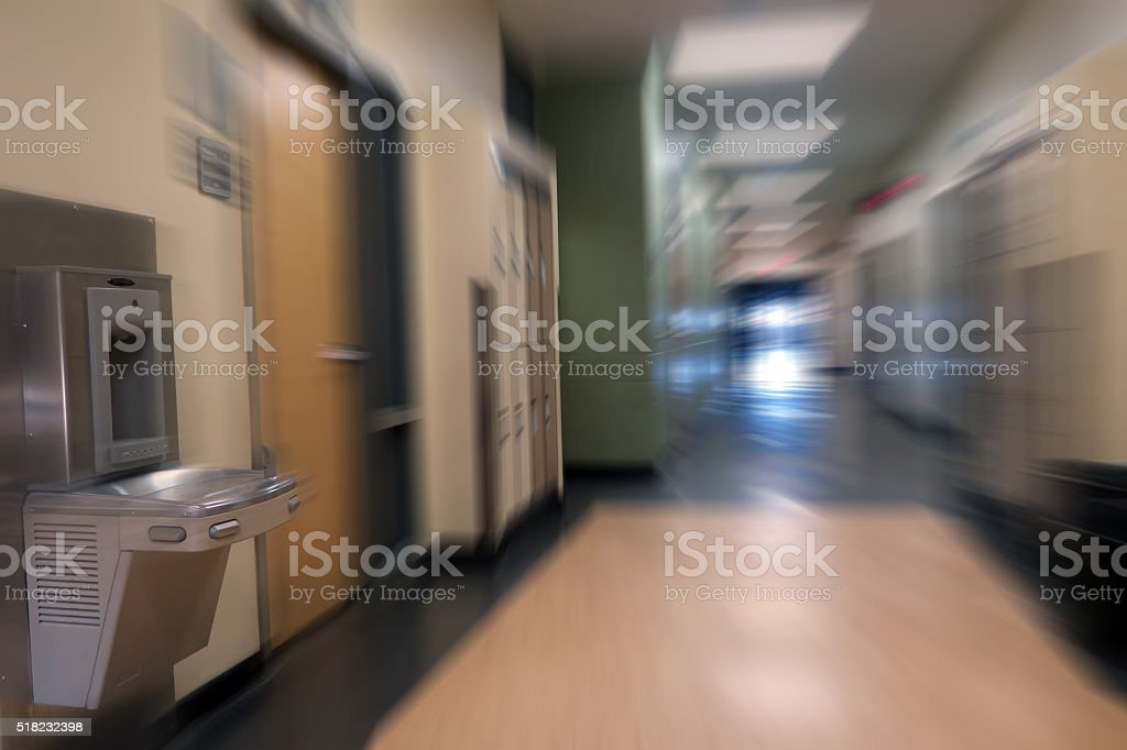Student lockers in an open school hallway- bokeh effect stock photo
