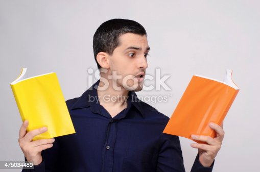 840623324istockphoto Student looking amazed at the books. Surprised teacher. 475034489