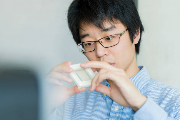 Student looking at a 3D printed piece stock photo
