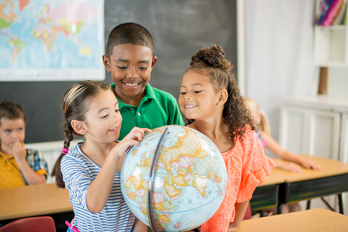 Student Looking At A Globe Stock Photo - Download Image Now