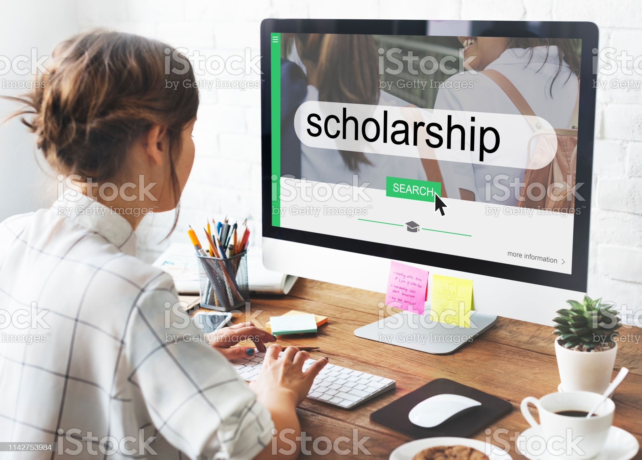 Student looking for scholarships Online education Achievement Stock Photo