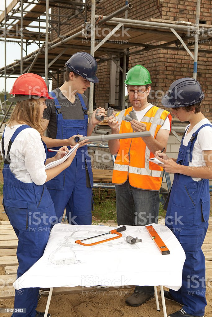 Student making notes. Learning for pipefitter. stock photo