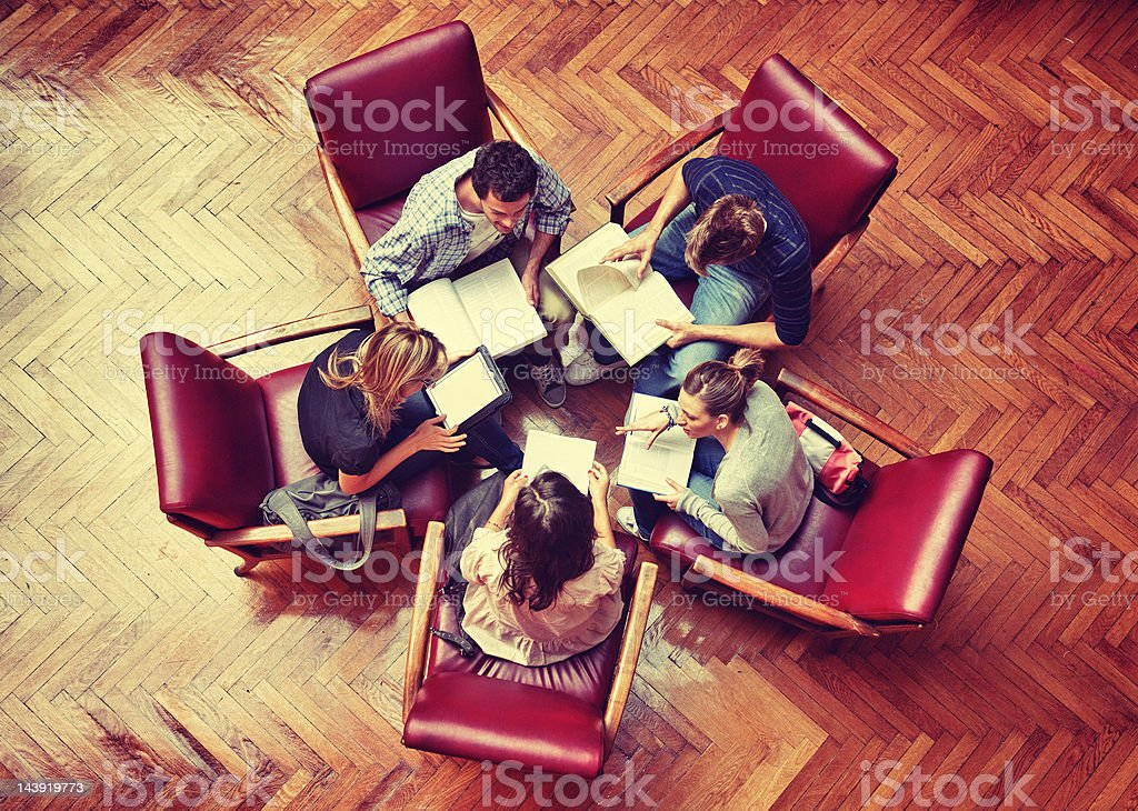 Student meeting in library - Teamwork royalty-free stock photo