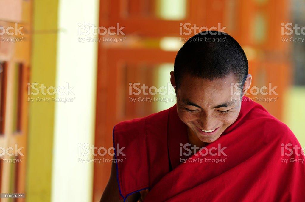 Student monk bowing at Jonangpa School in Kathmandu, Nepal stock photo