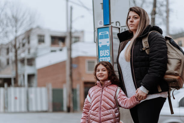 Student mother going to study with her daughter stock photo