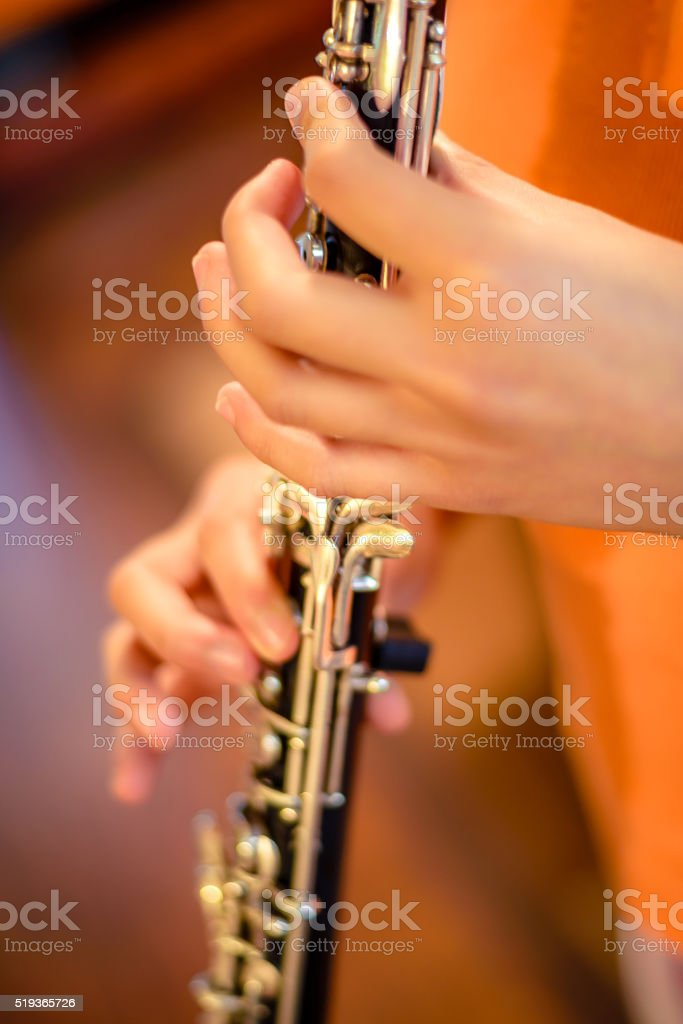 Student musician practicing the oboe stock photo