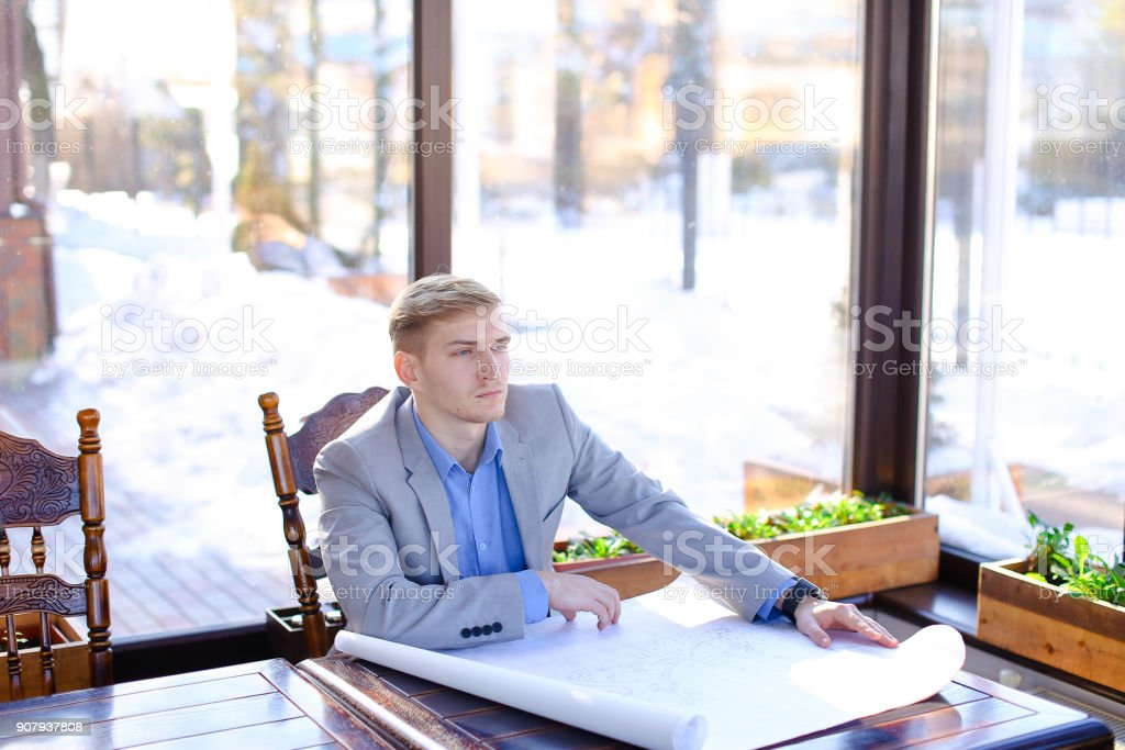Student of architecture faculty looking at drafting work at cafe stock photo