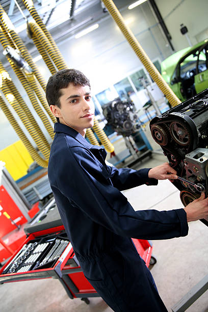 Student of mechanics in a garage stock photo
