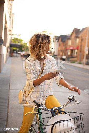 Student on Bike using cellphone