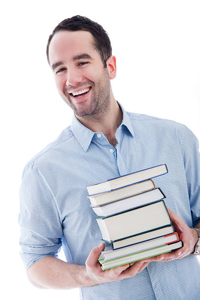 Student or Teacher Holding a Stack of Books stock photo