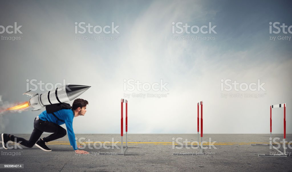 Student overcomes obstacles of his studies at top speed with a rocket foto stock royalty-free