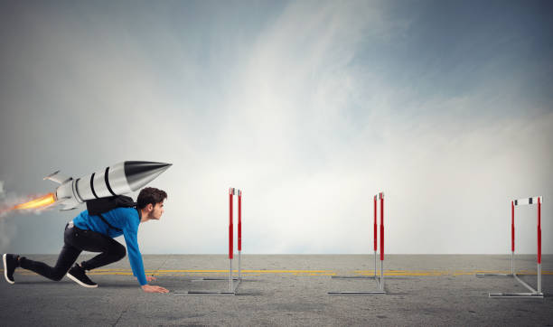 Student overcomes obstacles of his studies at top speed with a rocket - foto stock