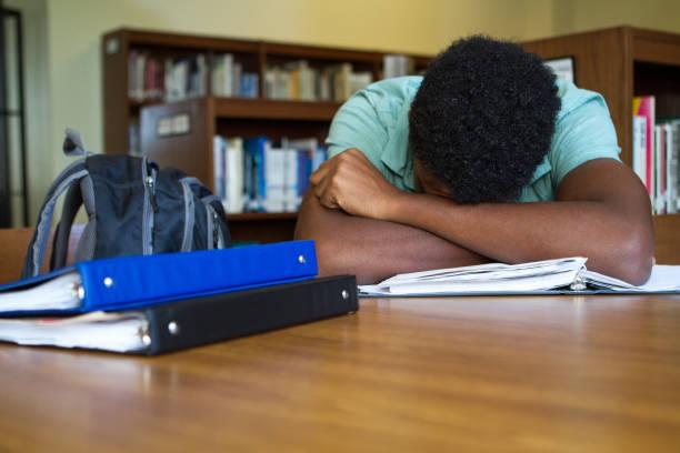 Student overwhelmed with homework stok fotoğrafı