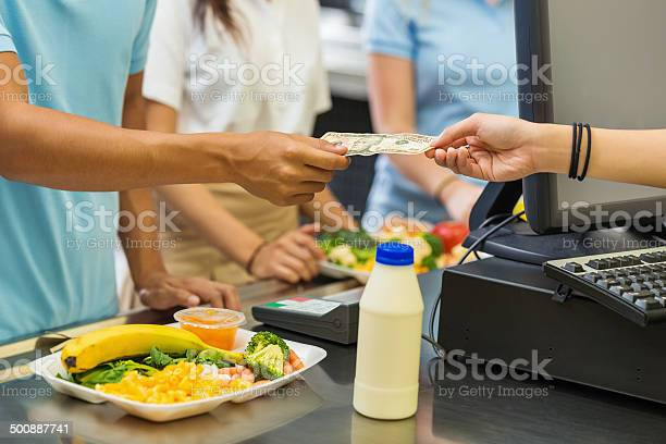 Student paying for school lunch with cash in cafeteria picture id500887741?b=1&k=6&m=500887741&s=612x612&h=icawqesjnmujdifhhlsbutoi0kiqqvtfnawk33 uvtw=