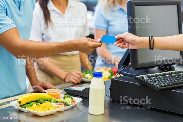 Student purchasing school cafeteria meal with credit card picture id498732757?b=1&k=6&m=498732757&s=612x612&h=b5bchbqvytca76ejxupn4uh9frem4tpur639tq019ky=