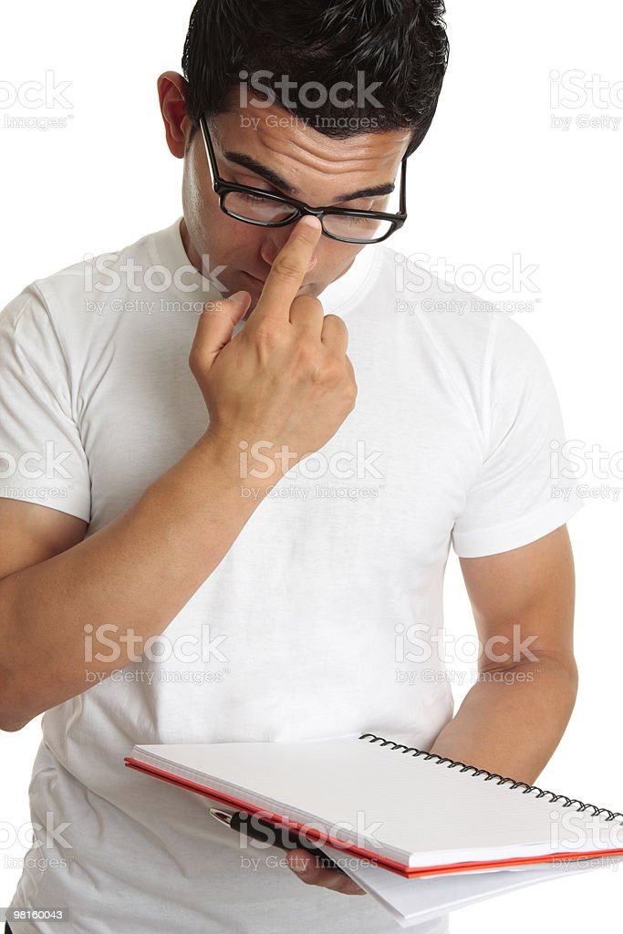 Student pushing up glasses onto face royalty-free stock photo