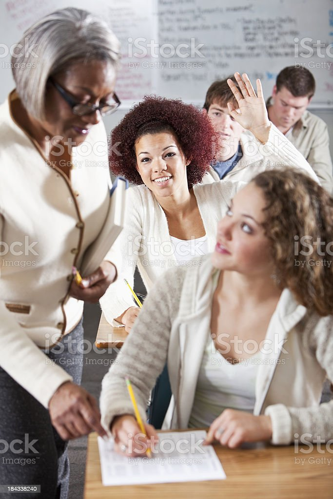 Student raising hand in class royalty-free stock photo