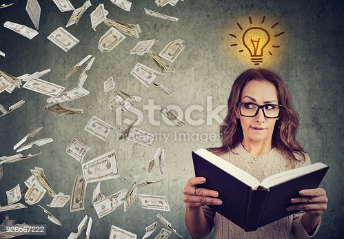 istock student reading a book has a bright idea how to earn money 926567222